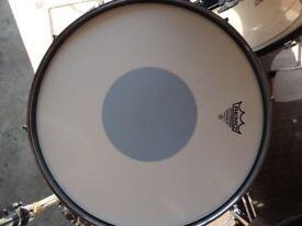 Pearl Export Black Snare drum.