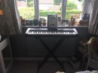 Casio Keyboard with adjustable stand and beginners book - Great Condition for sale