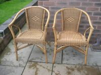 Two adult cane chairs.