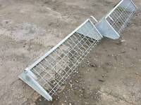 Sheep calf horse hang on hay feeder rack farm stables tractor