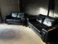 dark brown / black lether sofas good order apart from a rip on one side