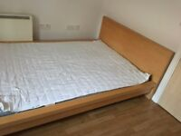 A used beach colour double bed (160mm) width bed for sale in SE1
