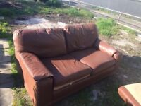 Pair of leather sofas ( one a sofa bed ) Can Deliver