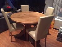 Round Oak Table and Four Leather Chairs