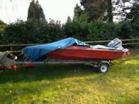 Fletcher speed boat hull and trailer. Red boat.