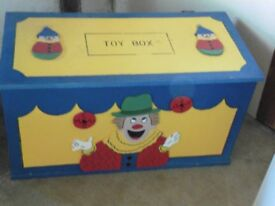 Toy Box. Large well constructed wooden box with hinged lid. Brightly painted.