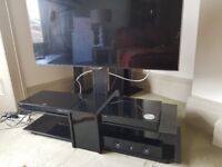 Excellent Condition Black and smoked Glass Flat Screen Stand