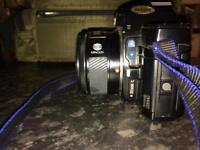 Minolta film camera plus 3 lenses and a carry case