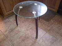 2 matching glass end tables