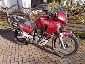 Honda Transalp XL650 motorbike - red. With some spare parts and a set of motorcycle tyres