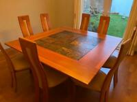 Stunning 8 seater square dining room table and chairs