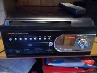 Cd/mp3 record player with radio/cassette.