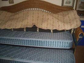 substantial iron frame and wicker Trundle Bed