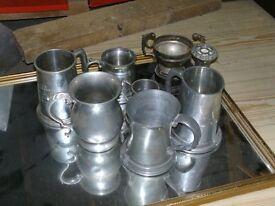 selection of pewter mugs