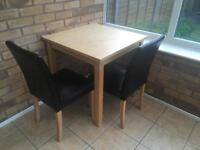 2 chairs and dining table