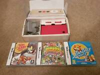 Pink nintendo dsi with box and 3 games
