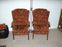 Two Matching Highback Winged fireside Chairs