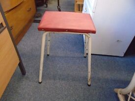 small metal frame and leather seat stool.