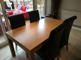 Dinning room table and 4 faux leather chairs
