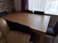 Dining table and 6 chairs for sale!