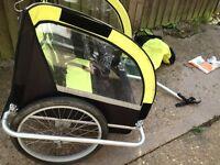 Double bike trailer folds flat