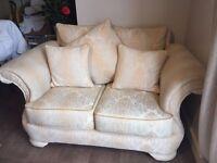 Cream two seat sofa
