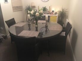 Large round black patio table and 6 chairs . Excellent condition.