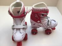 Girls size 3-6 pink and white roller skates