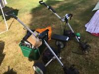 Two electric golf trolleys with loads of spares