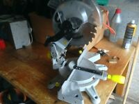 Mitre saw with cutting blade and protective guard in very good condition good working order