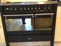 Smeg dual fuel range cooker with extractor hood