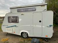 Trigano 340 TDE silver edition pop top caravan including motor mover