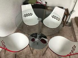 Glass table and 4 red chairs