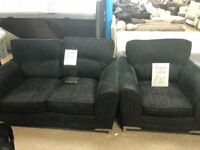 Lovely black settee and cuddle chair