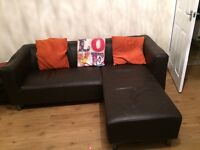 Brown leather sofa, arm chair and puffet