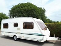 Abbey Aventura 4 Berth Fixed Bed Caravan With Accessories Included