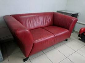 Red leather sofa bargain must go