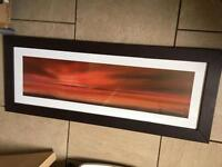 Brown leather picture with red sunset beach