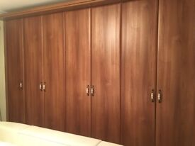 Bedroom wardrobes with matching bedside drawers
