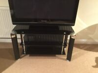Black glass and chrome TV stand c/w 2 shelves