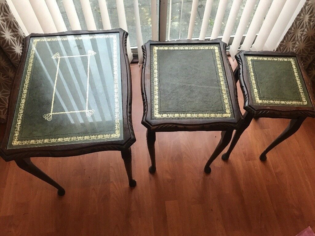 Set of three tables. Dark brown.