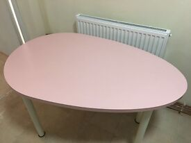 pale pink egg shaped table or desk top from Ikea with white legs c120cm x 74cm