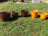 Five large ceramic Garden pots in red and orange shades