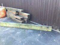 12 Wooden Garden Sleepers measuring 8ft long plus 6 offcuts of various lengths - collection only
