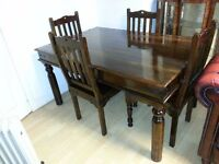 Lovely dark brown solid wood dining table and 4 chairs. excellent condition.