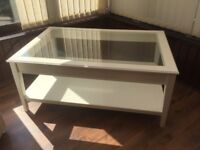 White Ikea glass top coffee table with base shelf