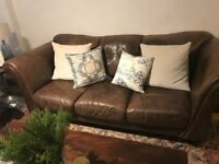 Three-seat chocolate brown leather sofa