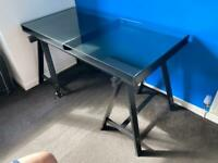 Black IKEA desk with glass top