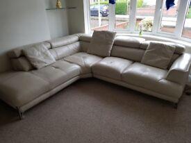 Leather dfs corner sofa with fold back headrest
