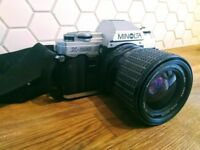 Minolta X300 SLR film camera with Sigma Zoom Master Lens and case
